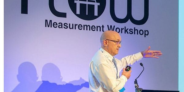 Gavin Munro on stage presenting at conference