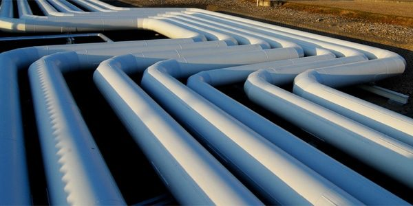 Oil field pipelines in desert surroundings